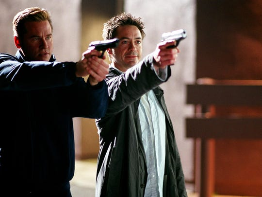 "Val Kilmer and Robert Downey, Jr. shoot 'em up in ""Kiss Kiss Bang Bang"" (2005)."