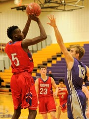 Abilene Cooper's Matthew Falade shoots over Canyon's