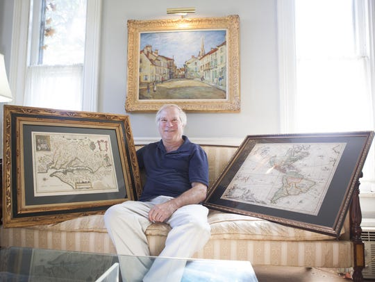 At his home in Staunton, Scott Ballin sits between