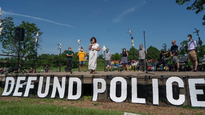 "FILE - In this June 7, 2020, file photo, Alondra Cano, a City Council member, speaks during ""The Path Forward"" meeting at Powderhorn Park in Minneapolis. The focus of the meeting was the defunding of the Minneapolis Police Department. A Minneapolis commission decided Wednesday, Aug. 5, to take more time to review a City Council amendment to dismantle the Police Department in the wake of George Floyd's death, ending the possibility of voters deciding the issue in November. (Jerry Holt/Star Tribune via AP, File)/Star Tribune via AP)"