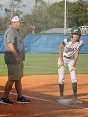 Former MLB all-star John Kruk coaches third base for the Seacrest softball team. Kruk is in his second season as the Stingrays' head coach.