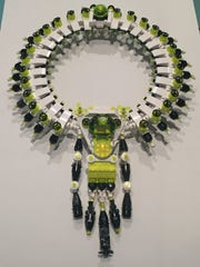 "This photo taken on Dec. 2, 2016 at the Los Angeles County Museum of Art in Los Angeles shows San Francisco jewelry artist Emiko Oye's 2008 ""Maharajah's 6th"" necklace, made entirely of Lego pieces, in the ""Beyond Bling: Jewelry from the Lois Boardman Collection"" exhibit. The exhibit features 50 jewelry pieces made from unconventional materials and belonging to Southern California collector Boardman's 300-piece jewelry collection, recently donated to the museum. The exhibit opened on Oct. 2, and runs until Feb. 5, 2017."