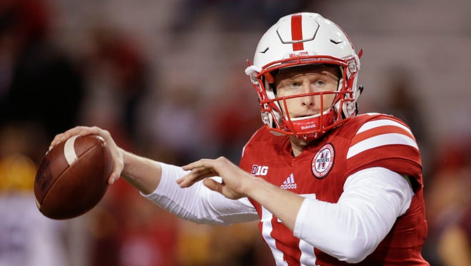 FILE- In this Nov. 12, 2016, file photo, Nebraska quarterback Ryker Fyfe warms up before an NCAA college football game against Minnesota in Lincoln, Neb. While wearing a cast on his left wrist and not able to take snaps from under center, Fyfe is the healthiest option Nebraska has at quarterback for the Music City Bowl against Tennessee. (AP Photo/Nati Harnik, File)