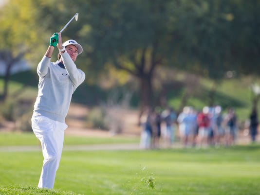 Bubba Watson hits from the rough on the 18th hole during the second round of the Waste Management Phoenix Open golf tournament, Friday, Feb. 2, 2018 in Scottsdale, Ariz. (Patrick Breen/The Arizona Republic via AP)
