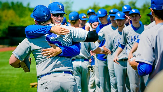 Drew Huard ,right, hugs Drew Cantrell after a game during Lansing Community College's 2017 season. Huard, 30, of Grand Ledge, is no longer the school's coach. He led the team that year to the Junior College World Series.