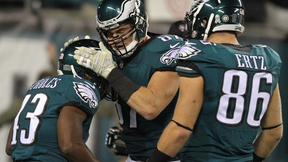 Eagles tight ends Brent Celek and Zach Ertz celebrate with Darren Sproles after his first-quarter touchdown run.