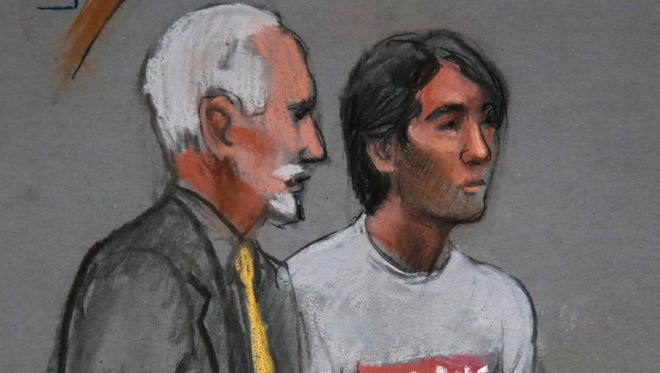 In this courtroom sketch, Khairullozhon Matanov, right, with attorney Paul Glickman, appears in federal court on May 30, 2014.