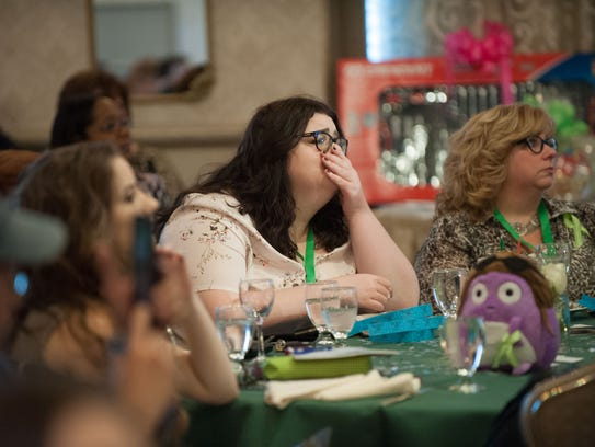 Bella Paleologos, center, of Jackson reacts as a video describes the events of Christina Grimmie's death during the East Coast kickoff event for the Christina Grimmie Foundation at The Mansion on Main Street in Voorhees on Saturday afternoon.