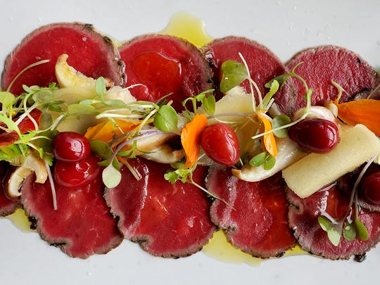 "Venison Carpaccio -- an Italian appetizer -- was made from venison tenderloin. Andre Ebert, the executive chef at The Accomac Inn, said it is ""very simple, but very nice."""
