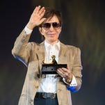 Film director Michael Cimino has died. In this photo, he waves at the Piazza Grande where he received the honorary 'Pardo d'onore Award' in 2015.