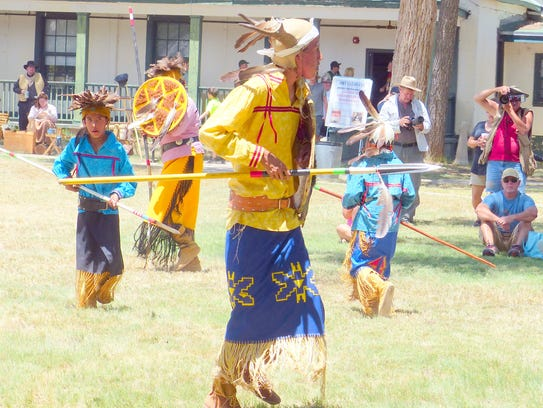 Dancers from the Mescalero Apache Tribe show visitors