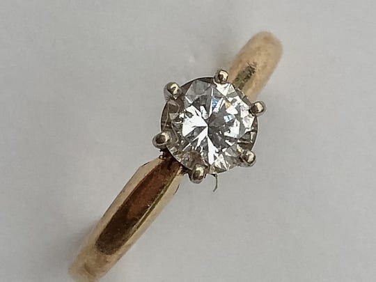Tom Flythe, a Pennsauken man who uses a metal detector as a hobby, recently found this diamond ring, lost a decade ago by a friend.