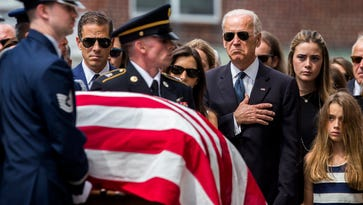The Biden family gathers as Beau Biden's casket is brought into St. Anthony of Padua R.C. Church in Wilmington on June 6, 2015.