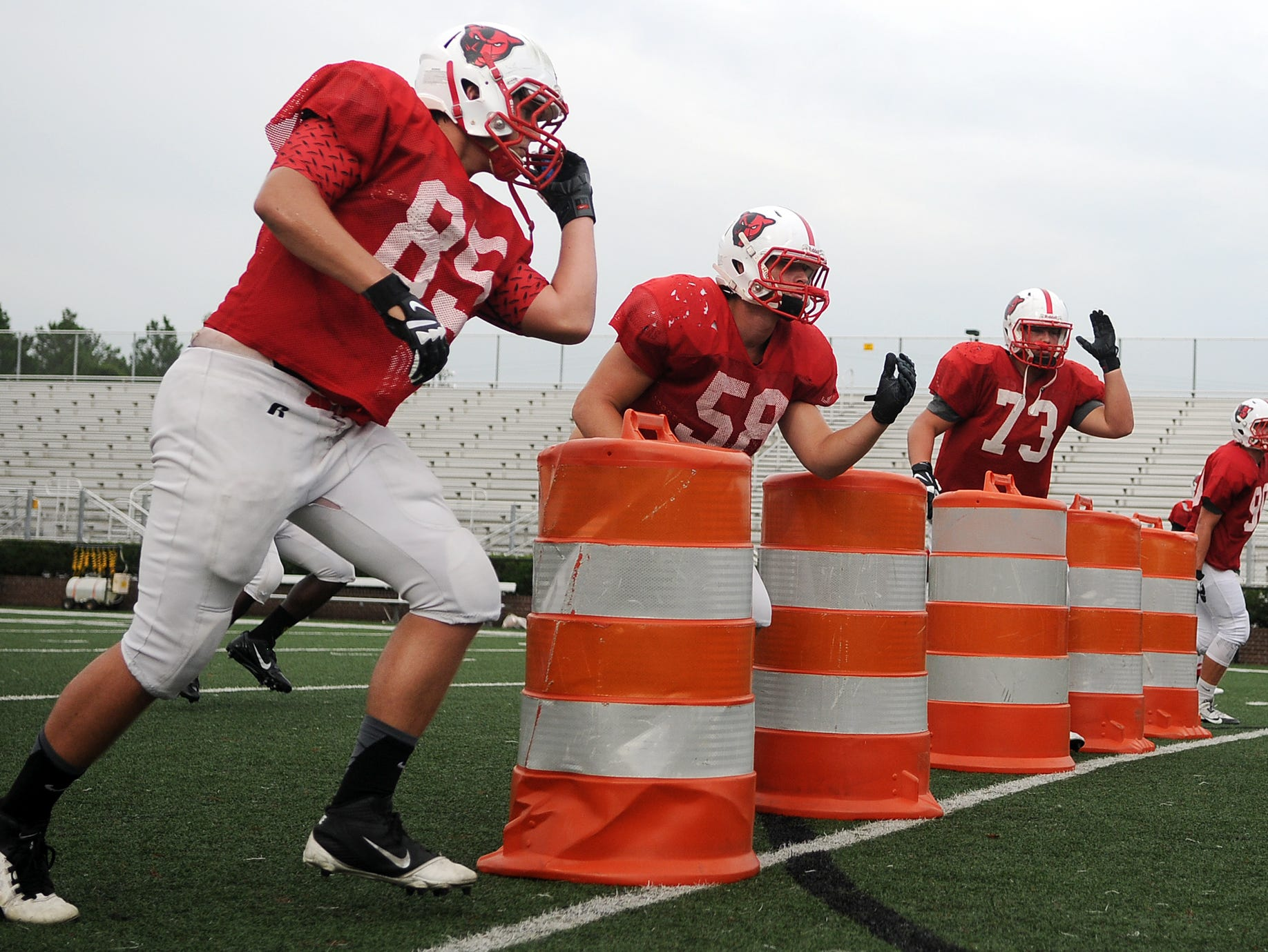 Petal defensive linemen work on pass-rushing techniques during a practice session this week, as the Panthers prepare for their game Saturday at Hattiesburg.