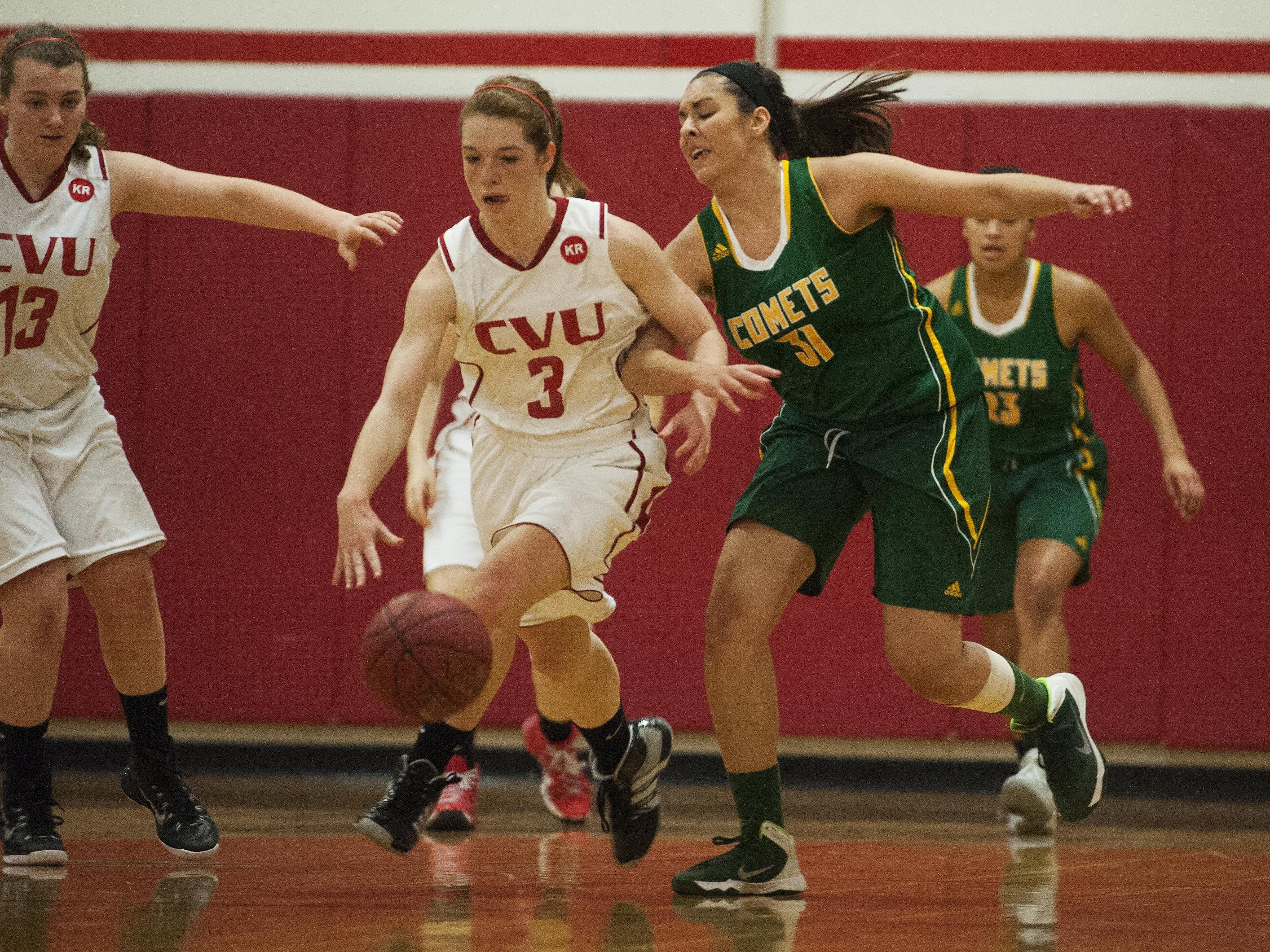 CVU's Sadie Otley (3) gets tangled up during a high school girls basketball game last season