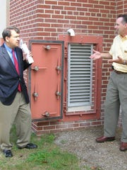 Assemblyman George Latimer, left, listens to Gregg Howells, executive director of the Rye YMCA, explains how flood gates installed around the Y facility will protect the building from rising flood waters.  The building was destroyed in the flood of 2007 and a $10,000 state grant secured by Latimer help defray the gatesÕ cost.  Donations from Y members, local businesses and the community provided additional support for the facilityÕs repair and reconstruction. Submitted by the Rye YMCA.  SA for SS