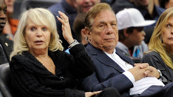 FILE - In this Nov. 12, 2010, file photo, Los Angeles Clippers owner Donald T. Sterling, right, sits with his wife Rochelle during the Clippers NBA basketball game against the Detroit Pistons in Los Angeles. An attorney representing the estranged wife of Clippers owner Donald Sterling said Thursday, May 8, 2014, that she will fight to retain her 50 percent ownership stake in the team.  (AP Photo/Mark J. Terrill, File) ORG XMIT: NY154