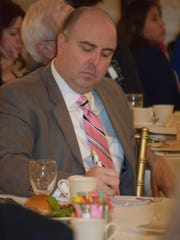 Photo/Jodi Streahle Joe Molineaux, director of the Family Economic Opportunity Center at the Family Service Association of South Jersey, jots down notes during the Marketing and Financing Main Streets Through the Heartland luncheon at Tomasello Winery on Wednesday, March 9.
