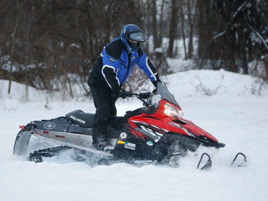 -ROCTab_01-11-2013_OurTownsWest_1_F005~~2013~01~09~IMG_CO_Snowmobile_010313_.jpg