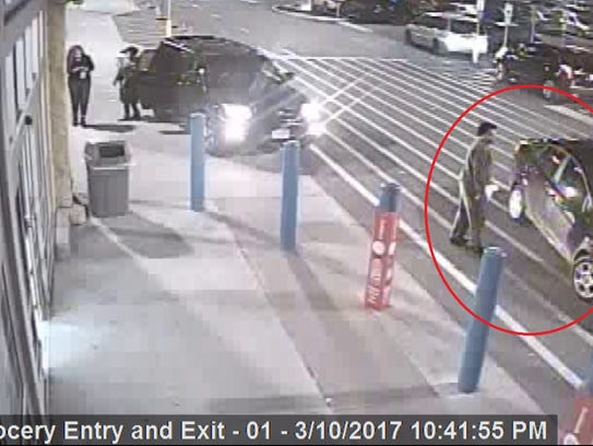 One of the suspects entering a car leaving Walmart
