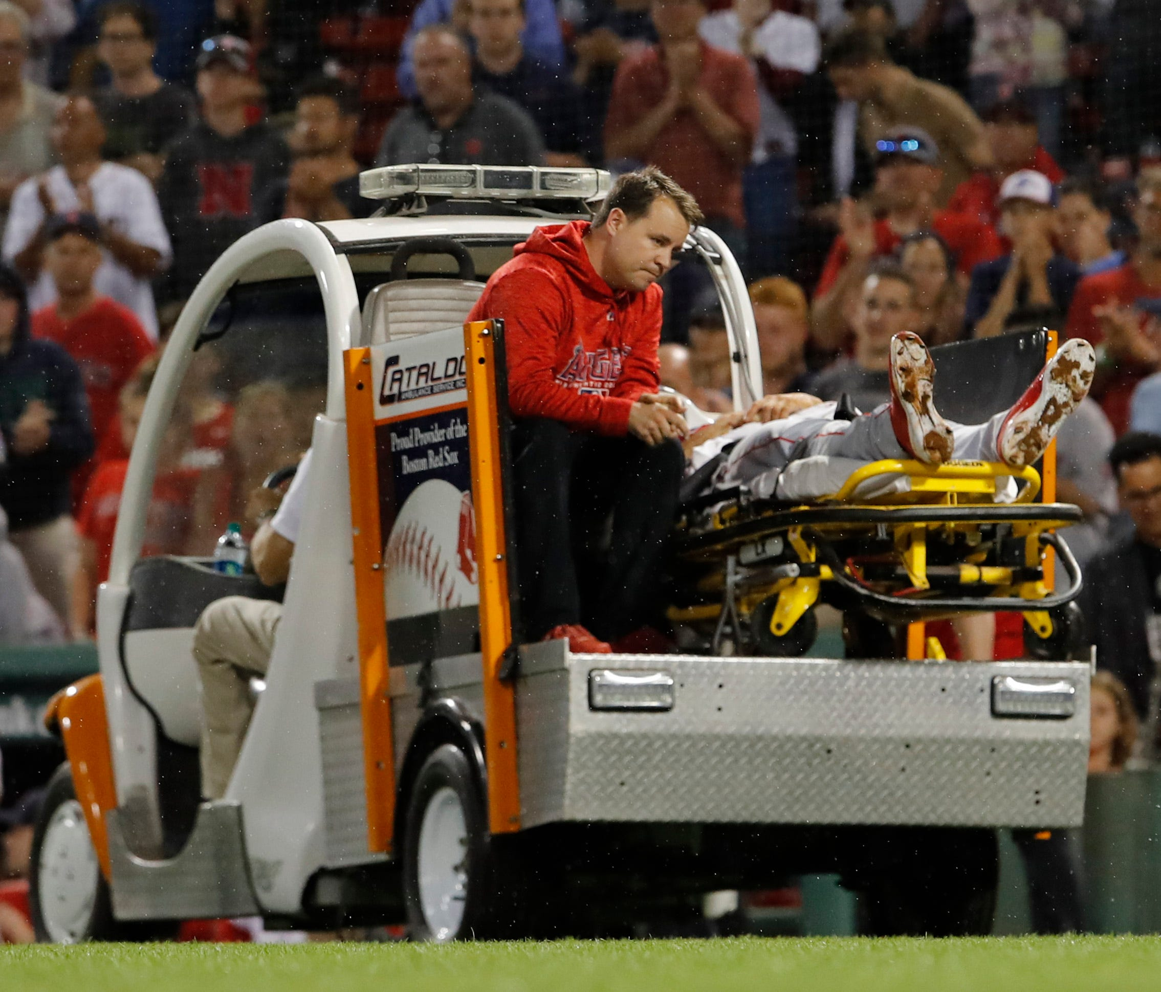 Angels pitcher Jake Jewell is taken off the field after being injured during a play at home plate.