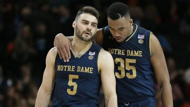 Notre Dame Fighting Irish guard Matt Farrell (5) and forward Bonzie Colson (35) react against the Virginia Tech Hokies during the second half of a second round game of the 2018 ACC tournament at Barclays Center at Barclays Center.