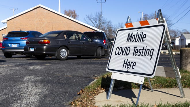 Cars line up in a circle in the parking lot of Pleasant Grove Baptist Church for the Southern Illinois University School of Medicine's mobile COVID-19 testing site, Friday, November 13, 2020, in Springfield, Ill.
