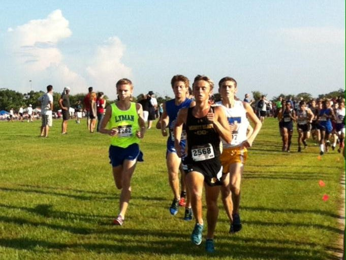 Steven Cross (in front in black) of Merritt Island High maintains his spot at the top of the Brevard high school cross country best performers.