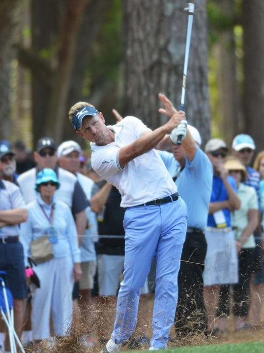 Luke Donald hits out of the pine straw along No. 9 fairway during the first round of the RBC Heritage Presented by Boeing on Thursday, April 13, 2017 at Harbour Town Golf Links on Hilton Head Island. Luke ended up the leader of the morning rounds at 6-under-par.  (Jay Karr /The Island Packet via AP)