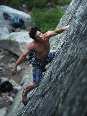 Climber Gabe Metzger makes his way up a granite wall up at Donner Pass near Truckee on June 30, 2015.