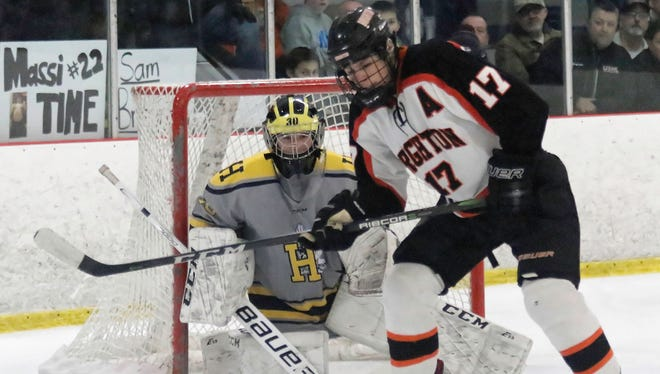 Brighton forward Adam Conquest (17) and Hartland goalie Brett Tome were two of Livingston County's eight first-team all-state hockey selections.