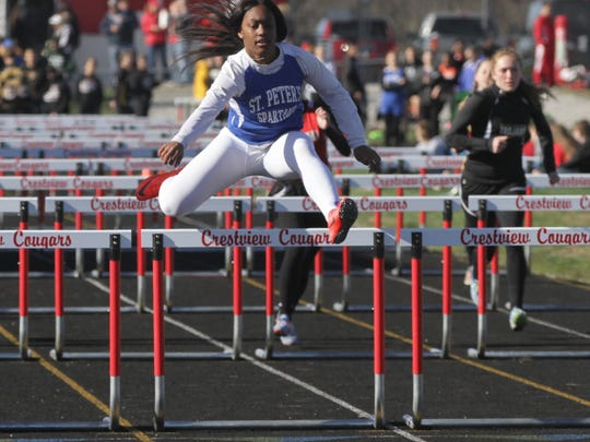 St. Peter's Alyssa Wade sets a Crestview Invitational record in the 100 hurdles (15.2) that stood for 23 years.