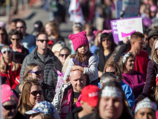 People from around the world gather at Sam Boyd Stadium in Las Vegas to listen to influential speakers and performers on the anniversary of the inaugural Women's March Sunday, Jan. 21, 2018.