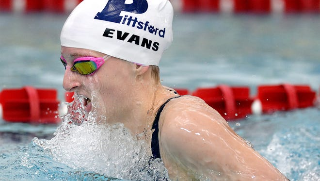 Pittsford's Becca Evans swims the 100-yard breaststroke during a meet at Fairport High School.