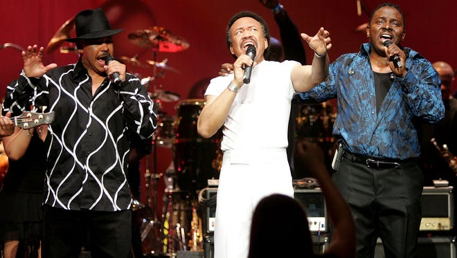 "Singers Ralph Johnson, (L) Maurice White, (C) and Philip Bailey of the band Earth, Wind and Fire perform during the inaugural ""Grammy Jam Fest"" at the Wiltern Theatre December 11, 2004 in Los Angeles, California. Maurice White dies Wednesday at 74."