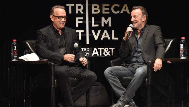 Tom Hanks and Bruce Springsteen speak on stage at New York's Beacon Theatre on Friday during the Tribeca Film Festival.