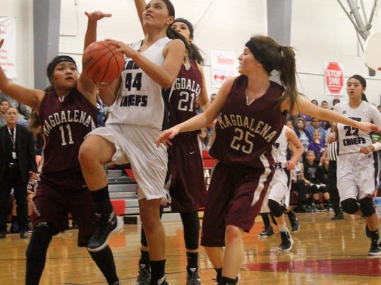 Lauryn Yuzos attempts a lay-up while being pressured by Shoshana Apachito (11), Michaela Zamora (21) and Melique Vinyard (25) on Saturday afternoon.