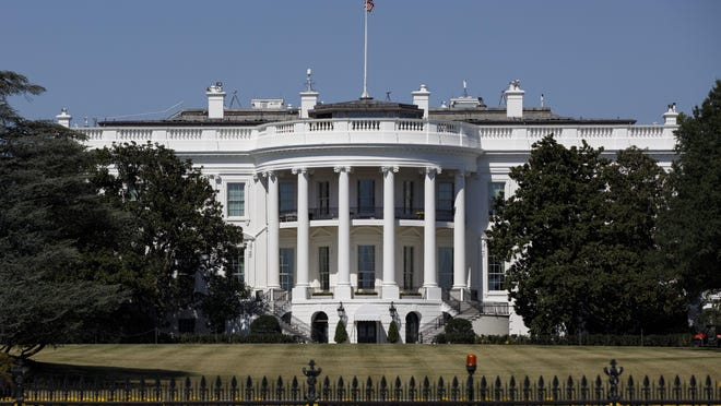 In this Sept. 25, 2019, file photo, The White House is seen from the Ellipse in Washington. Forty lobbyists with ties to President Donald Trump helped their clients secure over $10 billion in federal coronavirus aid. Among them are five former administration officials whose lobbying work potentially violates an ethics order Trump issued after taking office.