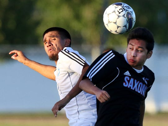 Woodburn's Anthony Santillan (left) scored the goal that gave the Bulldogs the 5A state championship.
