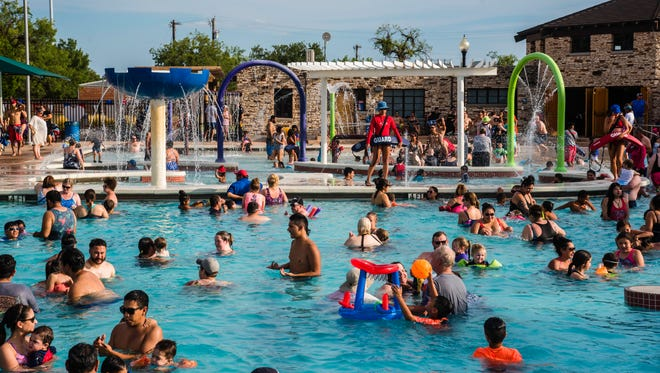 Hundreds cool off in the pool July 3, 2017, at Love Municipal Pool.