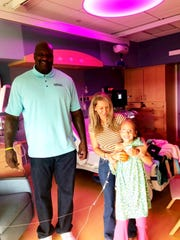 Former professional basketball player Shaquille O'Neal visits Ashlin Sanders (right) and her mother, Kristi Hays, in a Madison hospital.