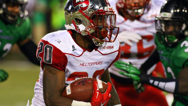 Western Kentucky Hilltoppers running back Anthony Wales (20), a former Central High standout, carries the ball against the North Texas Mean Green during the second quarter of game at Apogee Stadium.