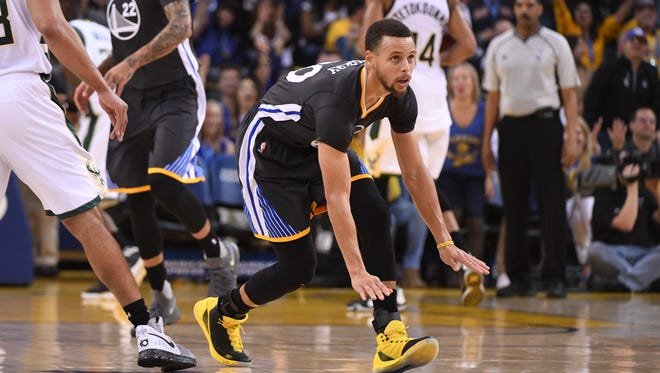 Golden State Warriors guard Stephen Curry (30) celebrates against the Milwaukee Bucks during the second quarter at Oracle Arena.
