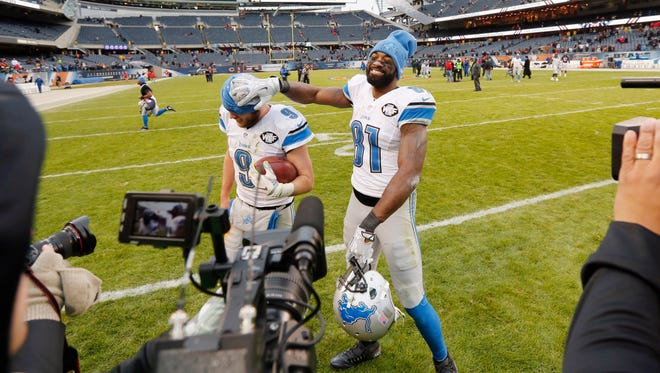 Detroit Lions wide receiver Calvin Johnson (81) clowns around with quarterback Matthew Stafford after a game Jan. 3, 2016, in Chicago.
