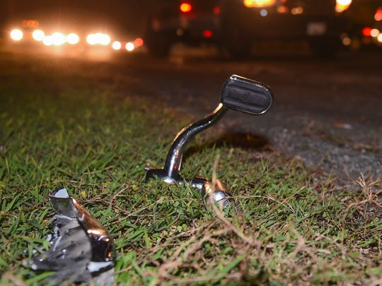 A broken right rear brake foot pedal rests near the southbound guardrail. It lay about 50 yards before a damaged Harley-Davidson V-Rod, found further down the shoulder.