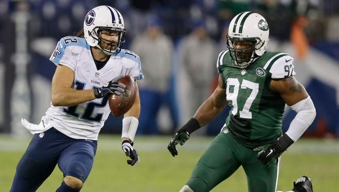 Titans quarterback Charlie Whitehurst scrambles away from Jets outside linebacker Calvin Pace on the final play of the fourth quarter.