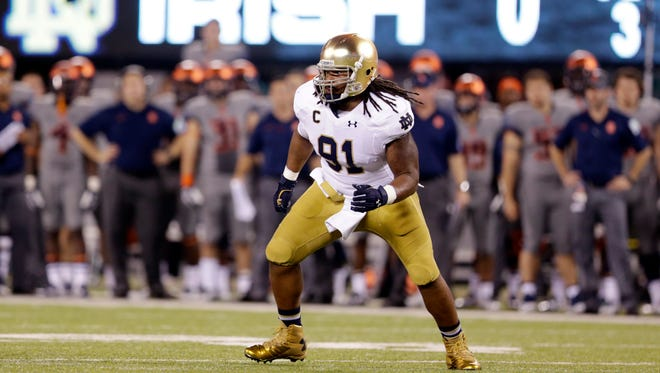 Notre Dame defensive lineman Sheldon Day defends against Syracuse during the first half of an NCAA college football game, Saturday, Sept. 27, 2014, in East Rutherford, N.J. (AP Photo/Julio Cortez)