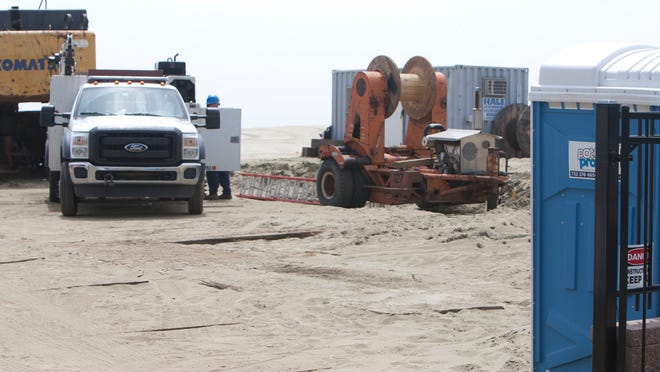 The Army Corps of Engineers investigate components of munitions on the Loch Arbor beachfront where beach restoration activities are occuring.