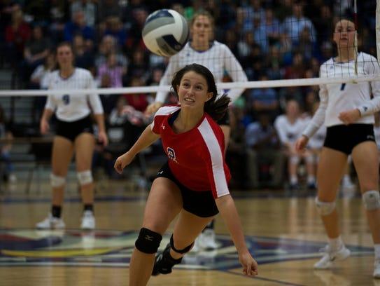 Gregory-Portland's Samantha Kuzma dives for the ball