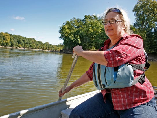 Rae Schnapp, Wabash Riverkeeper, rows along the Wabash